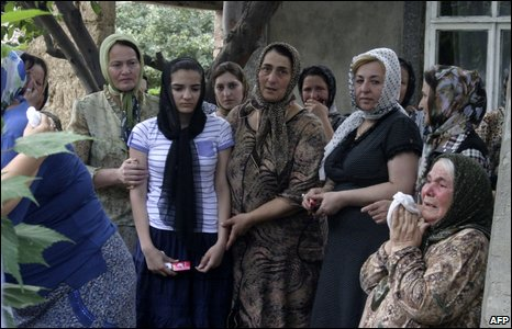 Natalia Estemirova's mother (with handkerchief) and daughter (in light tee-shirt) attend her funeral in Koshkeldy, 16 July