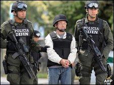 Police escort Cesar to his plane at Bogota's Catam airport, 16 July