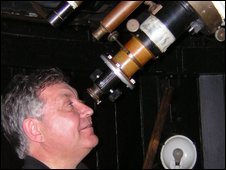 Kevin Kilburn looks through telescope