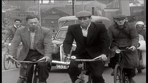 Steelworkers cycling to work in 1960