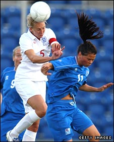 Faye White and Sara Gunnarsdottiir tussle for the ball