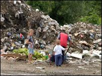 Children in a rubbish tip