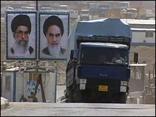 Portraits of Iranian leaders at the border crossing between Iraq and Iran