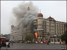 Smoke and flames billow out from the Taj Hotel, Mumbai, India, after a terrorist attack, 29 November 2008