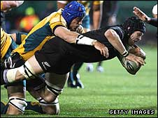 New Zealand captain Richie McCaw stretches over to score his side's try against Australia
