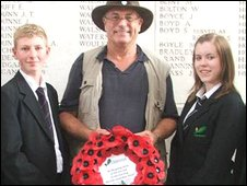 Former headmaster Andy Thompson with pupils at the Menin Gate