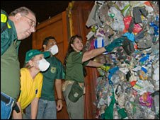 Brazilian environmental officials examine British waste at a cargo terminal at Guaruja near Sao Paulo