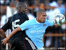 Dumiso Mabena (left) and Nigel de Jong in action in Saturday's match