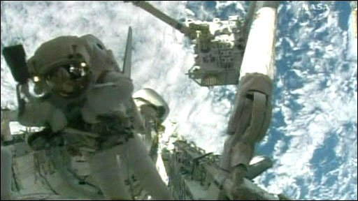 Astronauts on spacewalk