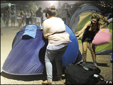 Women trying to save their tents