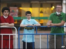 Quarantined British students, from left, Christopher Panayi, George Edge, and their teacher Ian Tyrrell