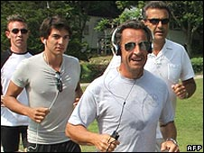 Nicolas Sarkozy (foreground) runs