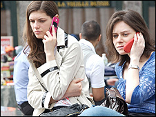Women talking on mobile phones (Image: BBC)