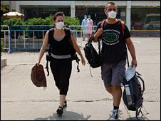 Two people leaving quarantine in Beijing