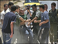 A settler is arrested during an incident at Hawarra checkpoint, near Nablus (20.07.09)