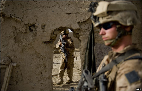 US Marines search a compound in the Garmsir district of Helmand Province, Afghanistan, 12 July 2009