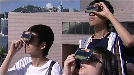 Amateur stargazers watch the longest solar eclipse of the century