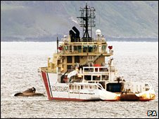 Coastguard tug Anglian Sovereign anchored near the upturned Aquila