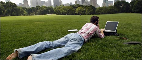Man in a park using a laptop