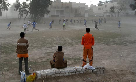A game of football in Baghdad - despite sand storm (Photo: Hugh Sykes/BBC)