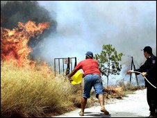 Volunteers quench fire (AP)