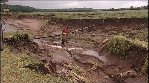 Trench created by floodwaters in Durham