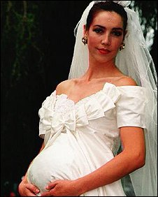 Pregnant bride in a wedding dress
