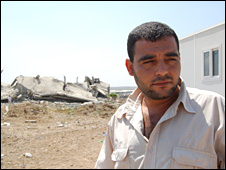 Samar Abed Rabbu's father Khaled, by the wreckage of their former family home in Jabaliya, Gaza