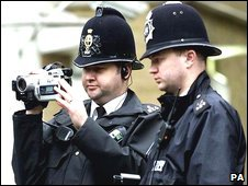 Officers with video camera (generic)