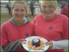 Girl Guides Cerys Dartnell (left) and Ashley Kelleher with the cheese