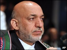 Afghan President Hamid Karzai is seen at the opening session of the 15th Non-Aligned Movement summit in Egyptian Red Sea resort of Sharm el-Sheik, Egypt, Wednesday, July 15, 2009.