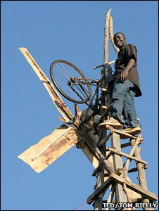 William Kamkwamba on his windmill (TED/Tom Rielly)