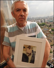 Alan Rees with a picture of Raymond Cutkelvin