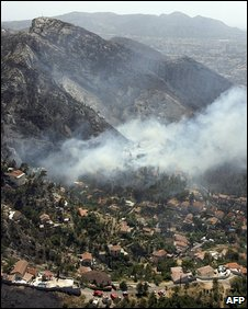 Aerial view showing smoke rising close to homes on the outskirts of Marseille