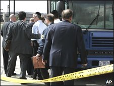 Unidentified detainees outside FBI offices in Newark, New Jersey, on Thursday