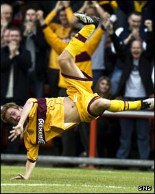 Paul Slane makes an acrobatic celebration