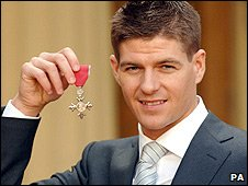Liverpool captain and England international Steven Gerrard with the MBE he was awarded in 2005