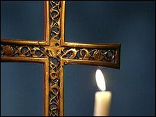 A cross and candle (file image)