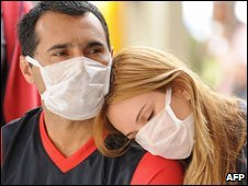 A man and woman wearing facemasks at a hospital in Rio de Janiero, Brazil (23 July 2009)
