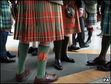 people in kilts