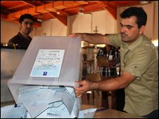 An electoral worker empties a ballot box containing the votes cast a day before by Kurds in the army, police, prison or the emergency services in the northern Kurdish city of Sulaimaniyah, some 330kms from Baghdad, on July 24, 2009.