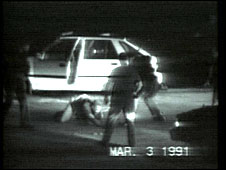 A still from the amateur video footage of LAPD officers beating Rodney King