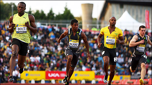 Usain Bolt (left) wins the 100m in London