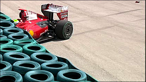 Felipe Massa's Ferrari in the tyre wall