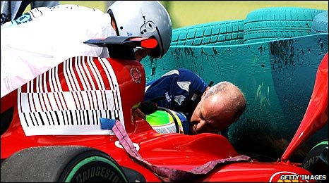 Felipe Massa is attended to by F1 medical officer Gary Hartstein