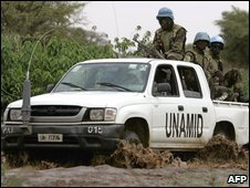 A convoy of the United Nations Assistance Mission in Darfur (UNAMID) crosses through a mud track in the southern village of Kashalongo, South of the city of Nyala, in southern Darfur on June 18, 2009.