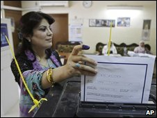 Iraqi lawmaker Ahlam Assad casts her ballot in an election for the Kurd-run region