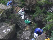 Rescue workers prepare the man for the journey to hospital