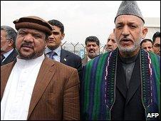 File photo of Mohammed Qasim Fahim (l) and Hamid Karzai in Kabul, May 2009