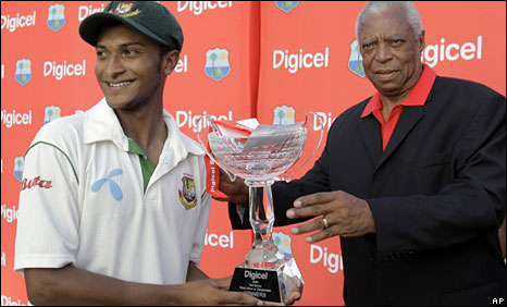 Bangladesh captain Shakib Al Hasan receives the Test series trophy from Windies legend Lance Gibbs